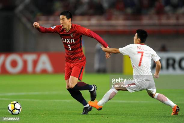 Gen Shoji of Kashima Antlers goes past Wu Lei of Shanghai SIPG during the AFC Champions League Round of 16 first leg match between Kashima Antlers...