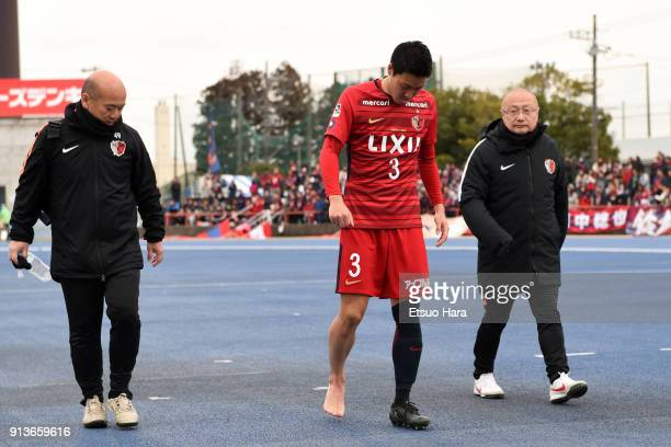 Gen Shoji of Kashima Antlers leaves the pitch being injured during the preseason friendly match between Mito HollyHock and Kashima Antlers at K's...
