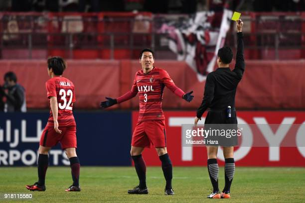 Gen Shoji of Kashima Antlers receives an yellow card during the AFC Champions League Group H match between Kashima Antlers and Shanghai Shenhua at...