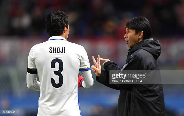 Gen Shoji of Kashima Antlers speaks to Masatada Ishii Coach of Kashima Antlers during the FIFA Club World Cup Semi Final match between Atletico...