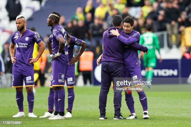 Gen Shoji of Toulouse celebrates victory with Assistant coach Jonathan Alves during the Ligue 1 match between Toulouse and Nantes at Stadium...