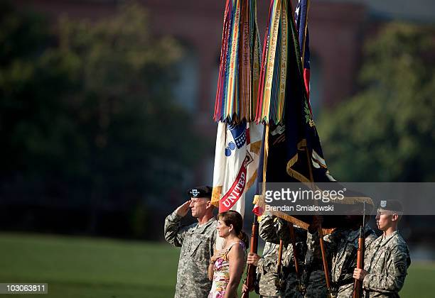 Gen Stanley McChrystal and his wife Annie listen to the national anthem during a retirement ceremony at Fort McNair July 23 2010 in Washington DC The...