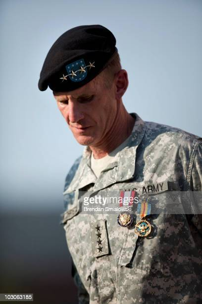 Gen Stanley McChrystal looks down after receiving the Department of Defense Distinguished Service Medal and the Army Distinguished Service Medal...