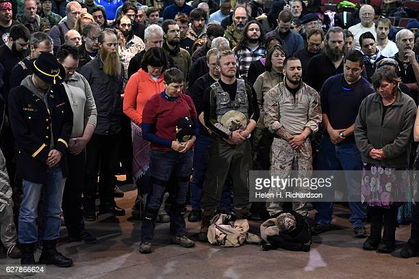 Gen Wesley Clark Jr far left and other veterans pray during an emotional forgiveness ceremony at the Four Prairie Knights Casino Resort on the...