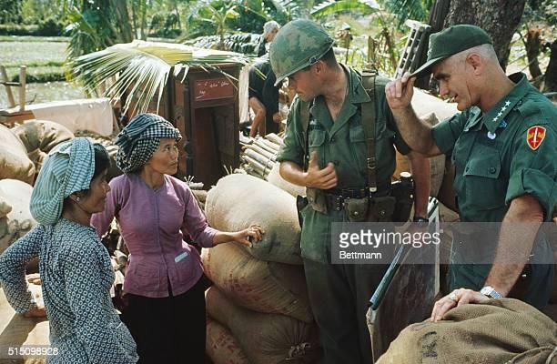 Gen William Westmoreland right speaking with Vietnamese women