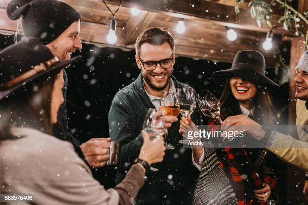 gen z celebrating christmas - christmas party stock photos and pictures