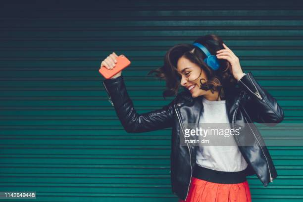gen z girl enjoying disco music - listening stock pictures, royalty-free photos & images
