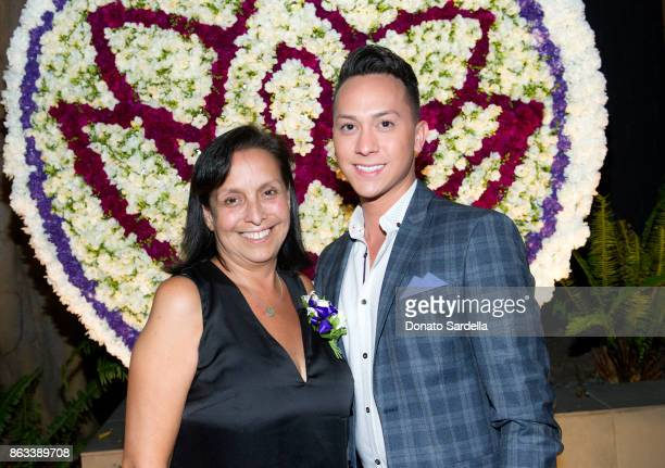 Gena Calderon and guest at Living Beauty 'The Gift' Photo Exhibit at The Buterbaugh Gallery on October 19 2017 in Los Angeles California