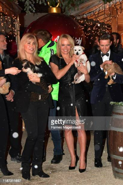 Gena O'Kelley and Pamela Anderson during the Gut Aiderbichl Christmas Market opening on November 12 2019 in Henndorf am Wallersee Austria