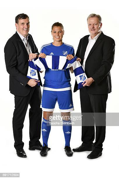 Genaral manager of Allianz insurance Joachim Koenig Claire Savin of SC Sand and genaral manager of Allianz insurance Juergen Koenig pose during the...