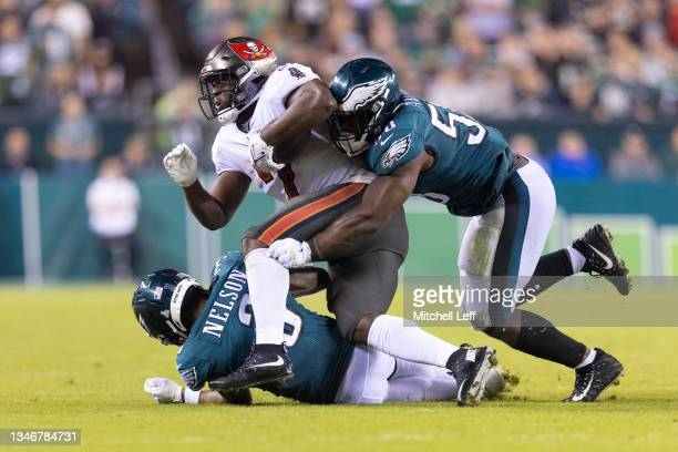 Genard Avery and Steven Nelson of the Philadelphia Eagles tackle Leonard Fournette of the Tampa Bay Buccaneers at Lincoln Financial Field on October...
