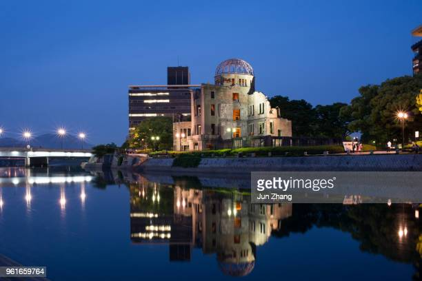 genbaku dome and the aioi bridge at night - nuclear fallout stock pictures, royalty-free photos & images