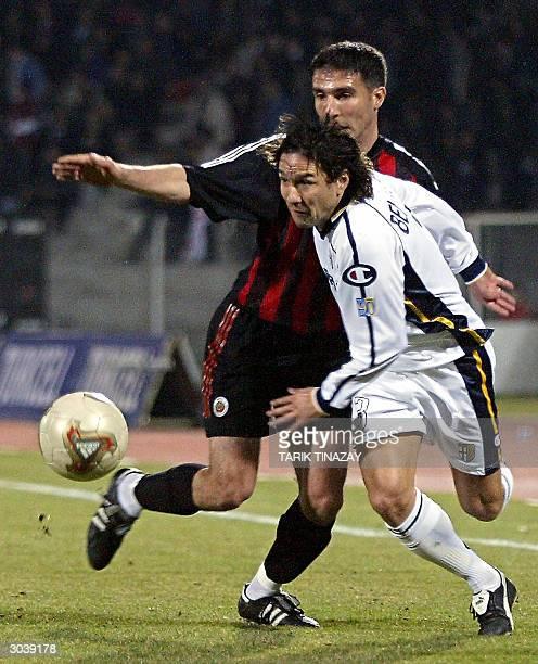 Genclerbirligi's Erkan Ozbey vies with Parma's Antonio Benarrivo during their UEFA Cup third round football match 03 March 2004 in Ankara AFP PHOTO...
