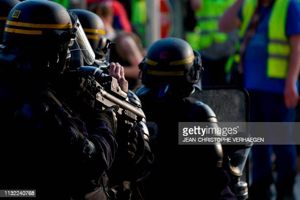 Gendarme holds a rubber bullets less lethal gun during an anti-government demonstration called by the 'Yellow Vest' movement in Metz, on March 23,...