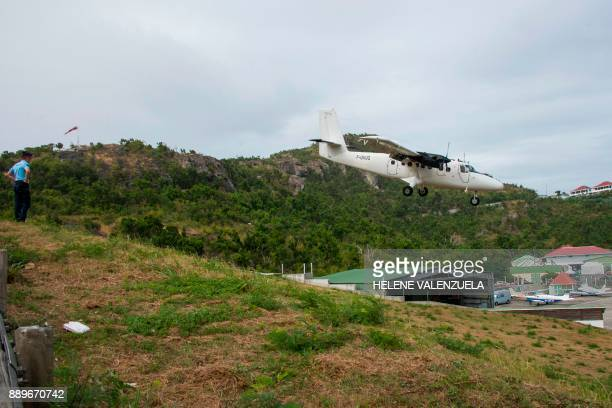 A gendarme patrols as a plane prepares to land at the SaintJeanGustave III airport on the French Caribbean island of SaintBarthelemy on December 10...
