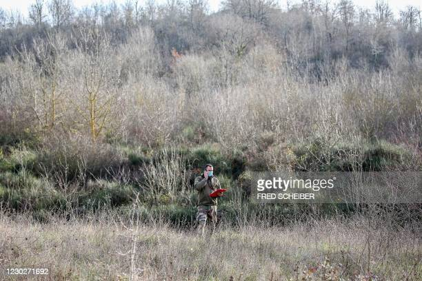 Gendarme speaks on the phone during the searches organised by the woods of Milhars, on December 23 to look for Delphine Jubillar, a woman missing...