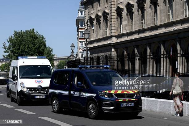 A Gendarme vehicle escorts a prison van transporting Felicien Kabuga one of the last key fugitives wanted over the 1994 Rwandan genocide to the Paris...