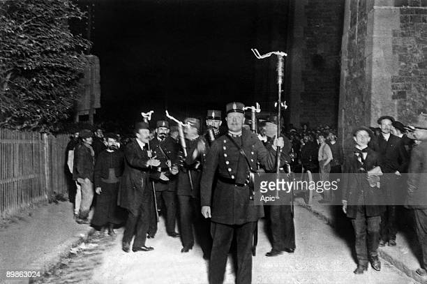 Gendarme with torch during assault on may 15 1912 of the house in NogentsurMarne where were Octave Garnier and Rene Valet members of Bonnot gang