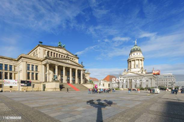 gendarmenmarkt square in berlin with  berlin concert hall and the french and german churches, berlin, germany - konzerthaus berlin stock pictures, royalty-free photos & images