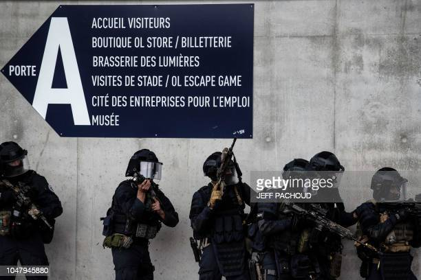 Gendarmeres take part in an attack exercise in Groupama Stadium in DecinesCharpieu near Lyon on October 9 2018 during the G6 Summit of Interior...