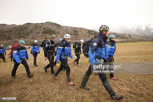 Gendarmerie and French mountain rescue teams arrive near the site of the Germanwings plane crash near the French Alps on March 24 2015 in La Seyne...