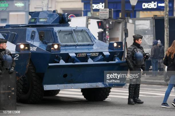 A Gendarmerie armored vehicle is parked in front of the Opera Garnier in Paris during a demonstration against rising costs of living blamed on high...