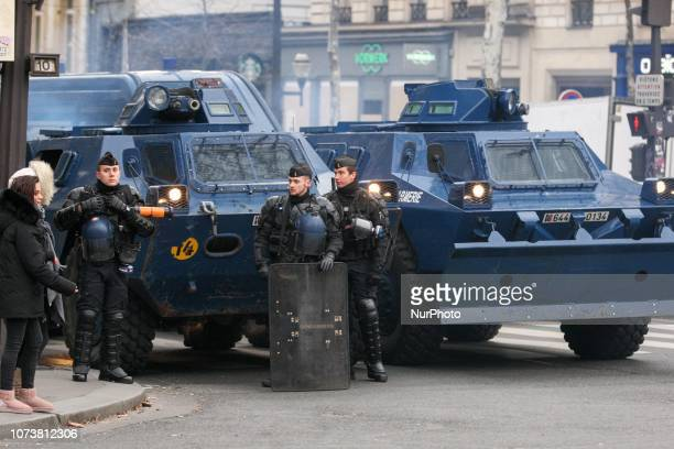 Gendarmerie armored vehicles are parked in front of the Opera Garnier in Paris during a demonstration against rising costs of living blamed on high...