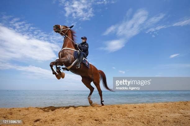 Gendarmerie mounted team members perform patrolling services at a beach of Sariyer district during the 3day coronavirus restrictions in 31 provinces...