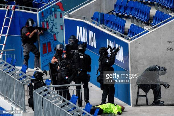 Gendarmerie officers take part in an attack exercise in Groupama Stadium in DecinesCharpieu near Lyon on October 9 2018 during the G6 Summit of...