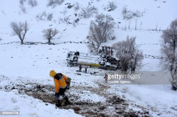 Gendarmeries and other officials inspect an overturned bus which killed 6 people and injured 29 at MusBingol highway's Gedik locality in Turkey's...