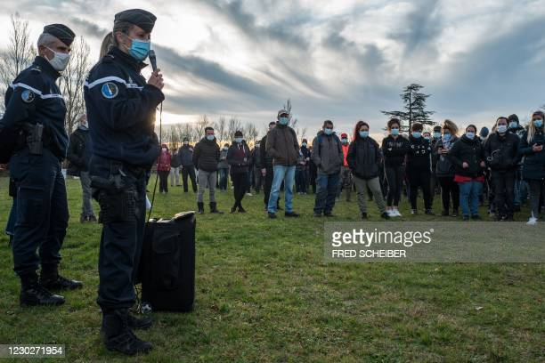 Gendarmes' Albi Company Commander Sophie Lambert gives indications to volunteers preparing for searches in the woods of Milhars, on December 23 to...