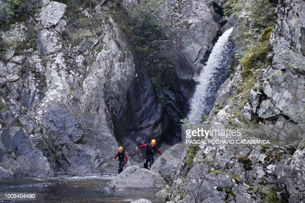 Gendarmes and firemen specialised in montain and water rescue search at the waterfall of the Zoicu canyon on August 2 2018 where four people died a...