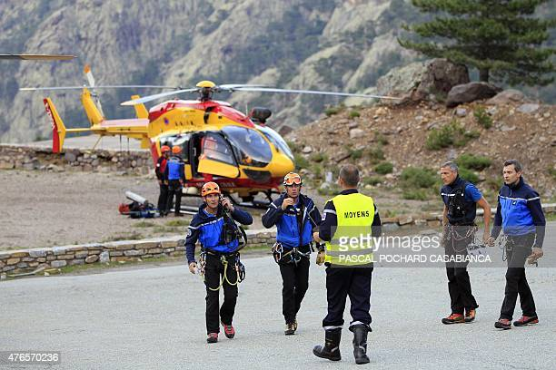 Gendarmes are pictured after bringing back dead tourists bodies by helicopter on June 10 near Asco in the French Mediterranean island of Corsica...