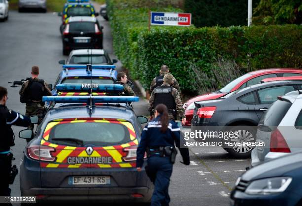 Gendarmes control the access to the gendarmerie headquarters of Dieuze, eastern France, on February 3 after a man was shot by a gendarme after...