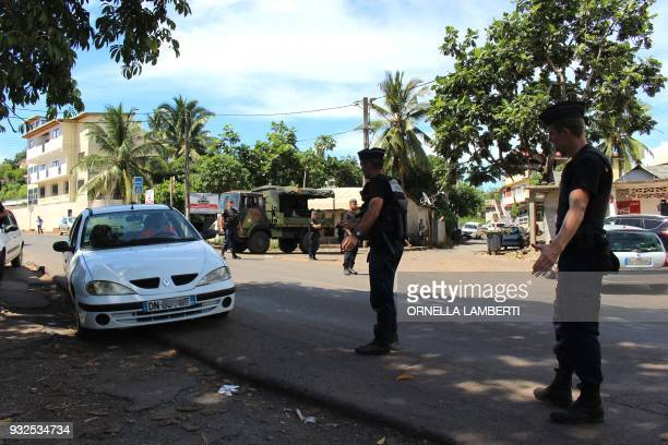 Gendarmes control the road traffic and check IDs on March 15 2018 in Majicavo in the French overseas territory of Mayotte Some 70 people believed to...