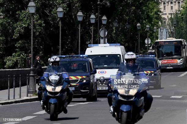 Gendarmes escort a prison van transporting Felicien Kabuga one of the last key fugitives wanted over the 1994 Rwandan genocide to the Paris court on...