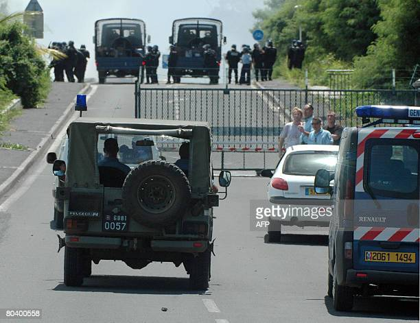 Gendarmes guard on March 27 2008 the entrance to the airport in Pamandzi Petite Terre belonging to the French island of Mayotte the archipelago's...