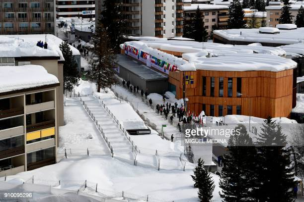 Gendarmes of the cantonal police stand on a roof to monitor the area near the Davos Congress Centre the venue of the annual World Economic Forum in...