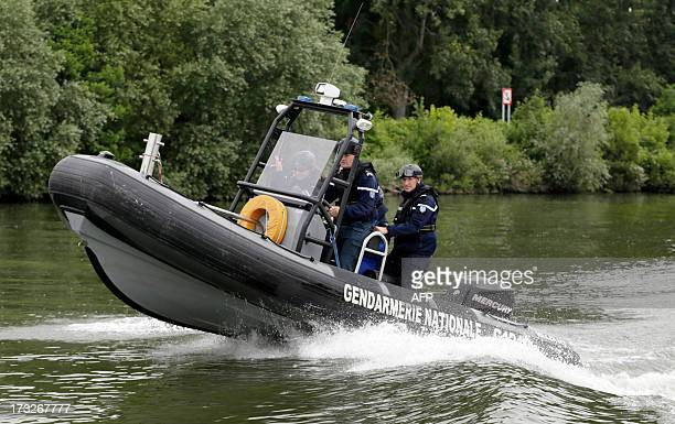 Gendarmes of the fluvial squad patrol on the Seine river on July 4 2013 in ConflansSainteHonorine The squad watch over waterways in the IledeFrance...