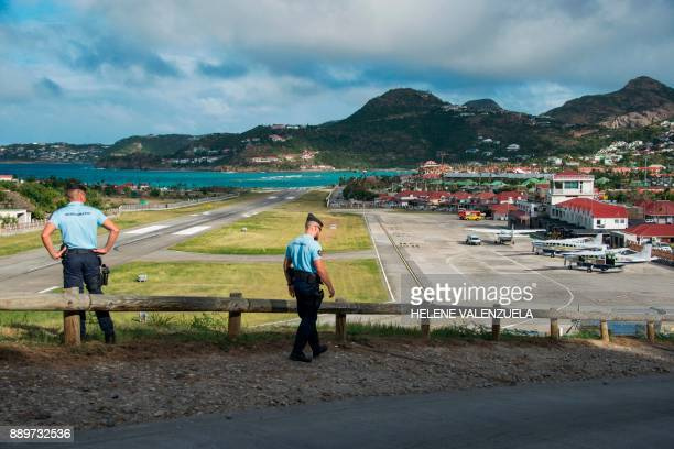 Gendarmes patrol at the SaintJeanGustave III airport on the French Caribbean island of SaintBarthelemy on December 10 prior to the landing of a plane...