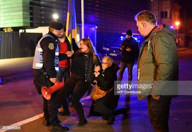 Gendarmes retain protesters next to the PSD ruling party headquarters during a protest in Bucharest November 12 2017 Around 3000 Romanians...