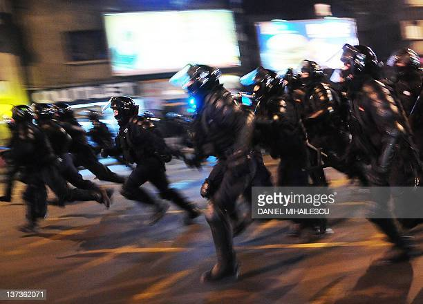 Gendarmes run against demonstrants next to Piata Universitatii square Bucharest January 19 2012 Thousands of Romanians rallied in Bucharest to...