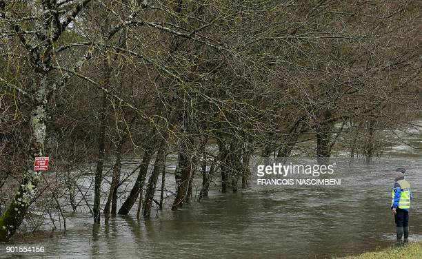 TOPSHOT Gendarmes search a 70yearold German citizen gone missing the day before on January 5 2018 near the flooded Aube river near RouvressurAube /...