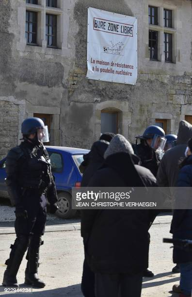 Gendarmes stand in front of the 'House of Resistance against Nuclear Waste' in Bure northeastern France on February 22 2018 French gendarmes began on...