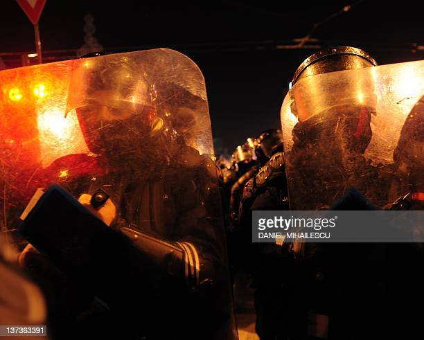 Gendarmes takes position against demonstrants in Piata Universitatii square Bucharest January 19 2012 Thousands of Romanians rallied in Bucharest to...