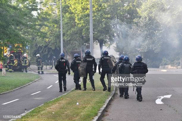 Gendarmes walk in a street in the Gresilles area of Dijon, eastern France, on June 15 as new tensions flared in the city after it was rocked by a...