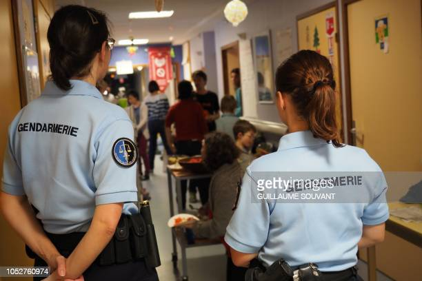 Gendarmes watch people occupying a corridor during a protest against the closure of a maternity hospital in Le Blanc, central France on October 22,...