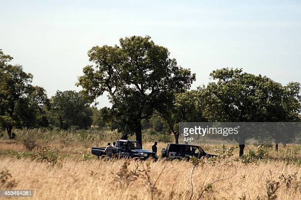 Gendarmes work on December 4 2013 in Diago outside Bamako in the area where twentyone bodies believed to be the remains of soldiers close to Mali's...