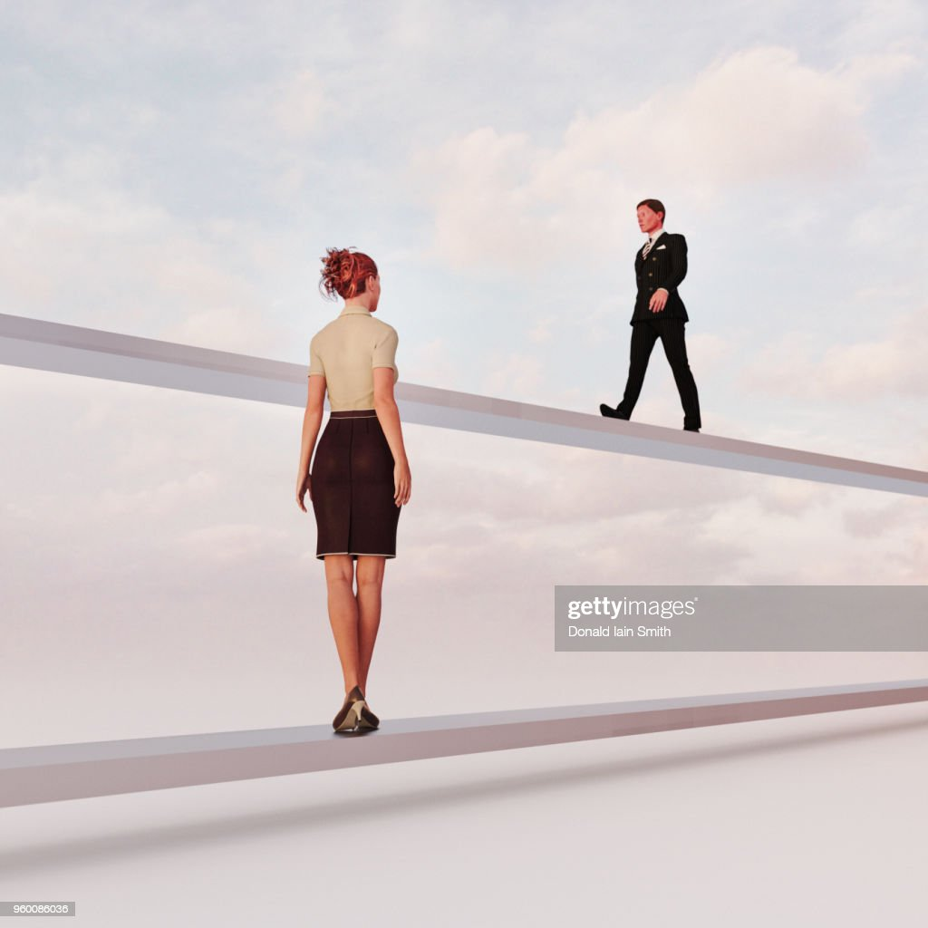 Gender inequality: man and woman on separate paths : Stock-Foto