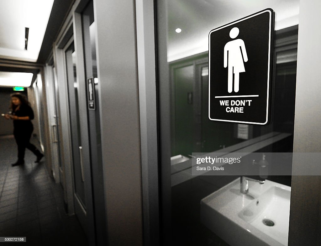 Gender neutral signs are posted in the 21C Museum Hotel public restrooms on May 10, 2016 in Durham, North Carolina. Debate over transgender bathroom access spreads nationwide as the U.S. Department of Justice countersues North Carolina Governor Pat McCrory from enforcing the provisions of House Bill 2 that dictate what bathrooms transgender individuals can use.